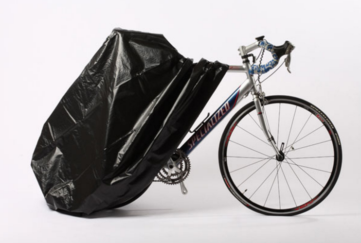 A bike partially covered by a Zerust bike cover.