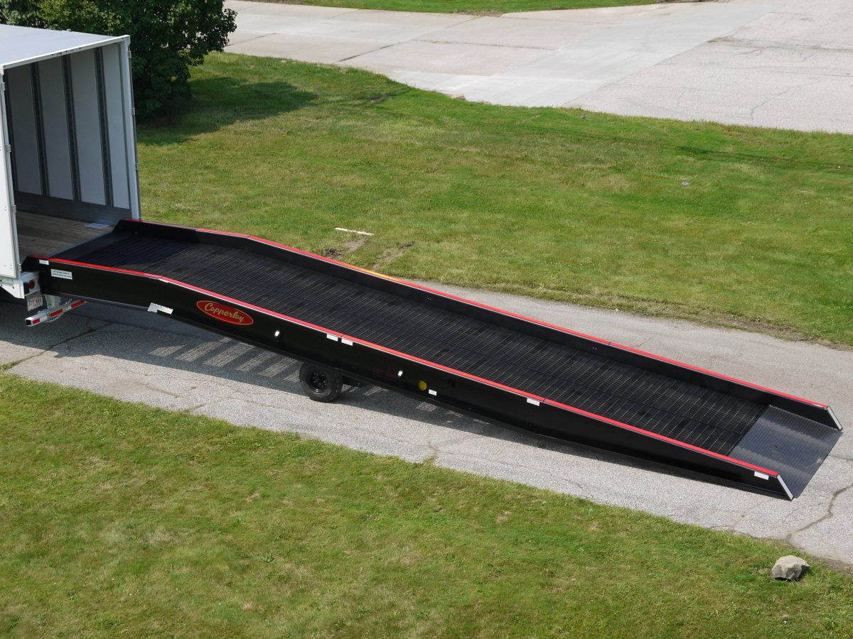 A distant view of one of Copperloy's Yard Ramps connected to a truck.