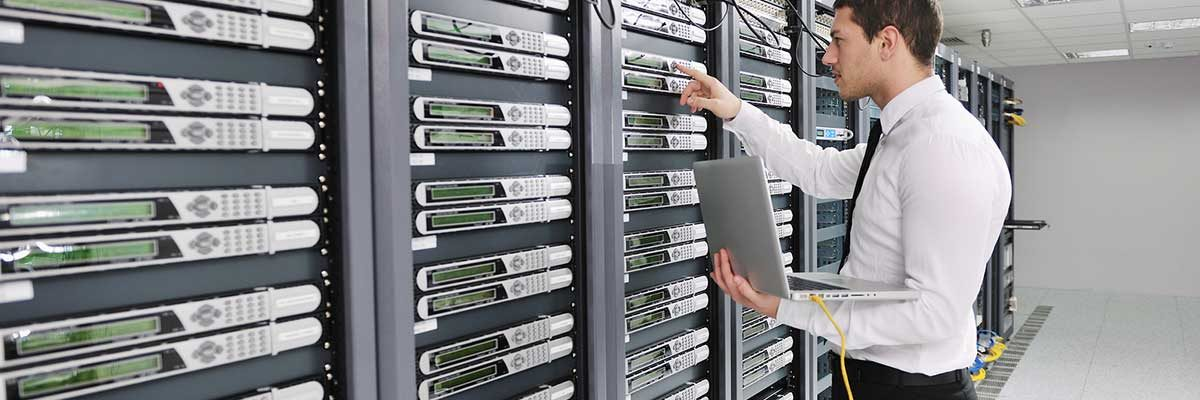 A technician working with a collection of servers. IT services Cleveland Ohio.